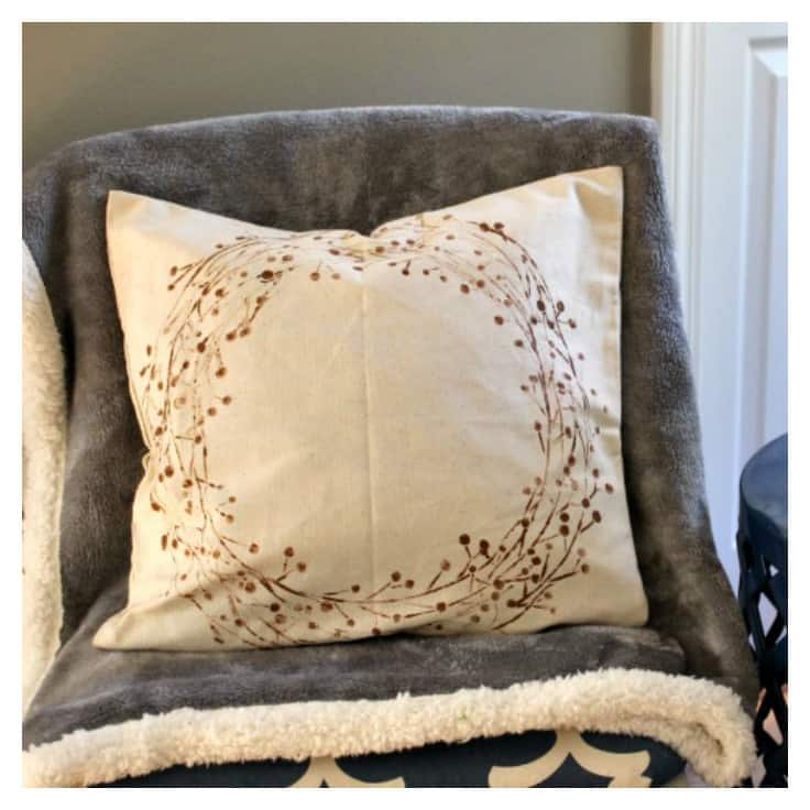 Learn how to make a beautiful double-sided stenciled pillow for your home! The best part about this tutorial...it's an easy no sew DIY that uses pillow covers! Perfect for living rooms or bedrooms! #diypillow #homedecor #kenarry