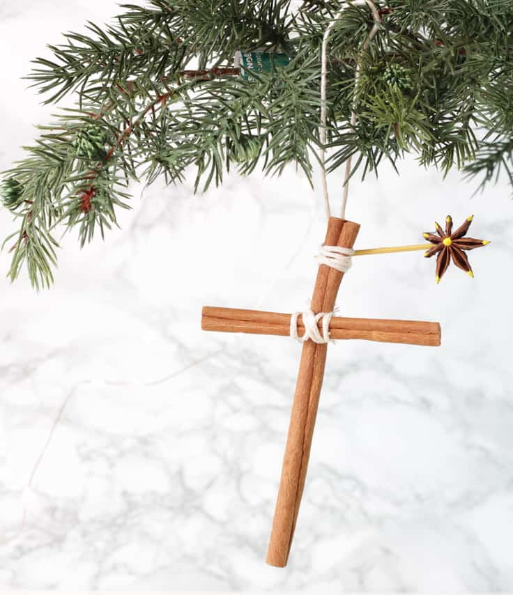 Find out how to make these beautiful homemade Christmas ornaments for your Christmas tree! These easy ornaments are made from cinnamon stick crosses with an anise star and smell totally amazing. It's a fun Christmas craft for kids to do! #christmas #christmascrafts #kenarry