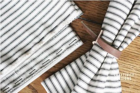 leather napkin rings, ticking stripe cloth napkins