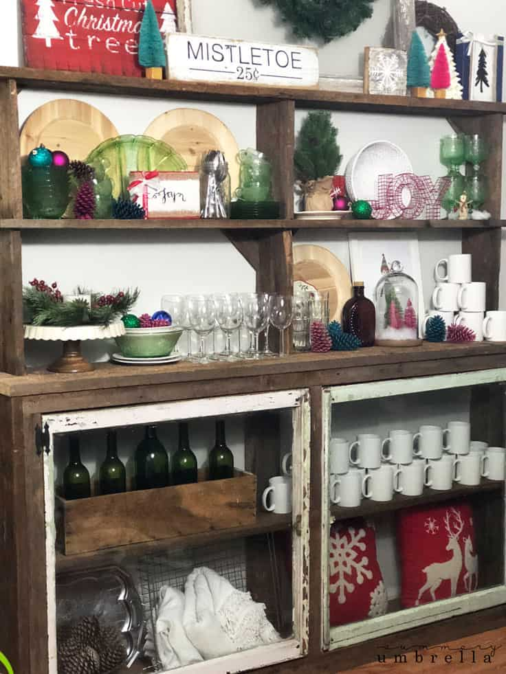 Bring a little farmhouse or rustic holiday season cheer into your home this year with handmade burlap Christmas signs! Not only can these painted wooden signs be created in a variety of colors, but they will also be a great DIY project for the whole family to enjoy. #christmasdecor #rusticdecor #kenarry
