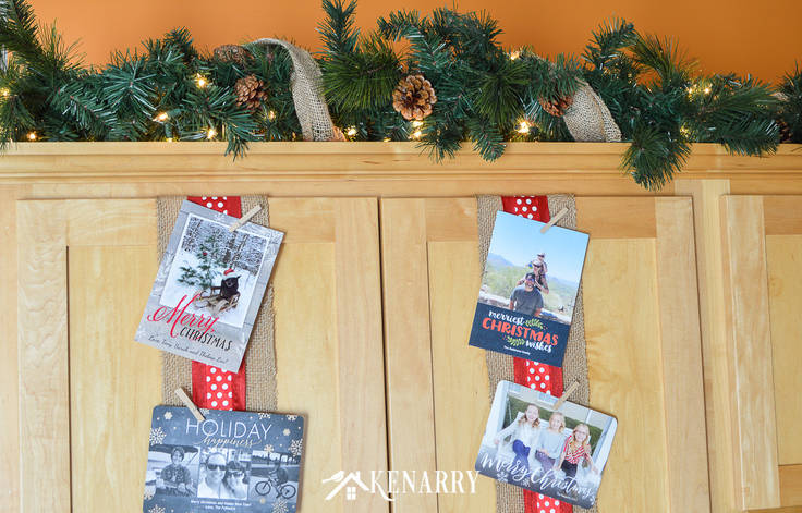 Use wide ribbon, burlap and small clothes pins for displaying Christmas cards on your kitchen cabinets so you can enjoy looking at them throughout the holidays.