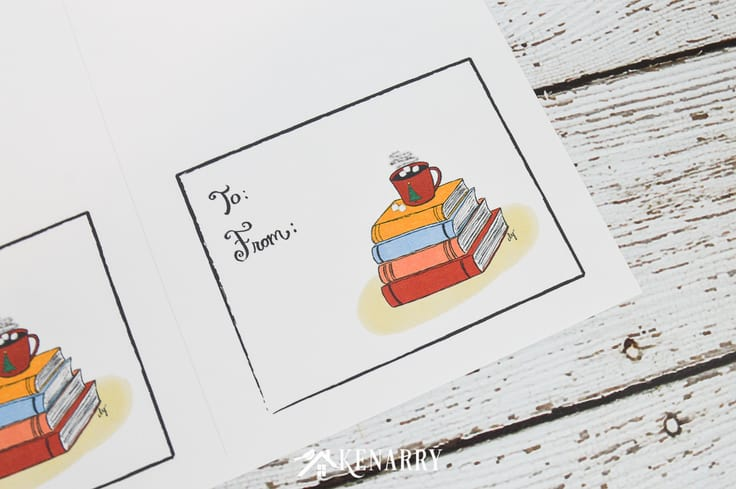 A close up of a card with blank to and from fields. Clip art of hot chocolate on top of a stack of books. This makes a cute card for giving gift cards.
