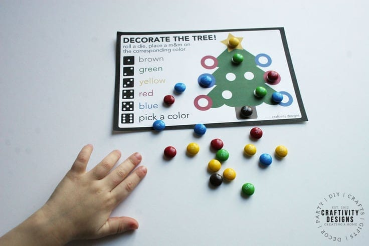 """Kids will enjoy playing """"Roll a Tree"""" at Christmas! This simple Christmas Game printable is easy to prep for a Christmas party or night at home."""