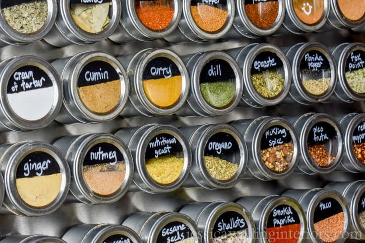 Spices taking over your kitchen? Make this easy DIY giant magnetic spice rack. It holds 36 different spices, and it could hold more if you want it to!