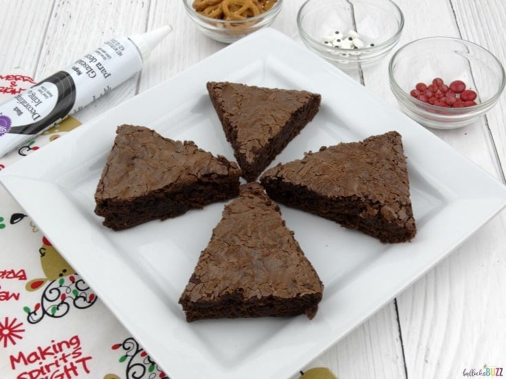 Cut cooled brownies into triangles to make reindeer brownies