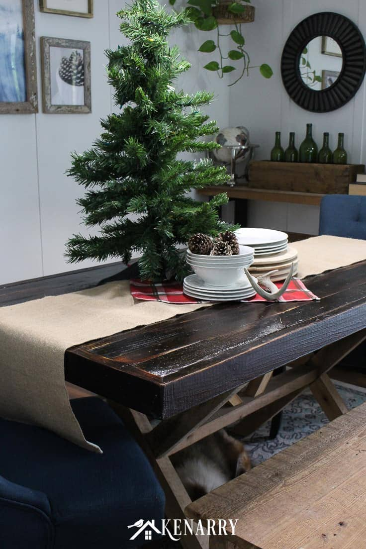A small Christmas tree, sleigh or a extra large holiday centerpiece on a burlap table runner adds height and dramatic style to your holiday decor and dining room table. #christmasdecor #rusticchristmas #kenarry