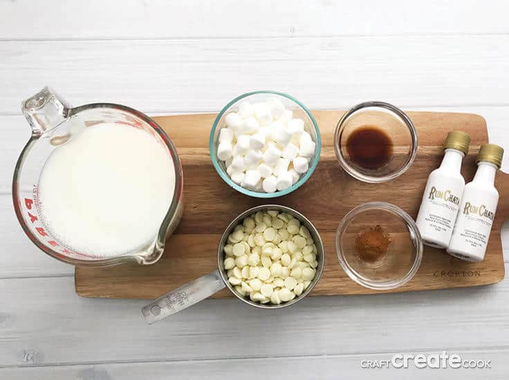 This homemade Spiked White Hot Cocoa recipe is perfect for the holidays! White chocolate flavored with some Rum Chata alcohol and topped off with whipped cream will be a huge hit at your hot chocolate bar!