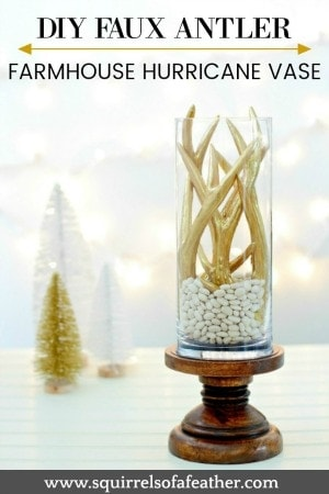 Holiday hurricane vase with gold faux antlers.