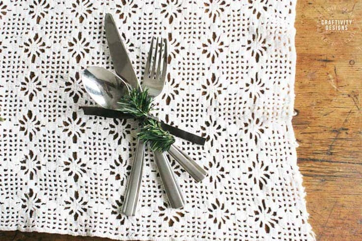 Make easy Christmas Napkin Rings with Leather and Evergreens.