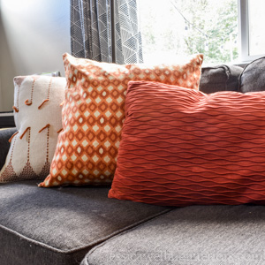 Sew your own super-easy throw pillow covers to save space and money! This step-by-step tutorial will show you how.