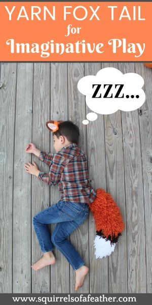 A cute boy wearing a fox tail costume