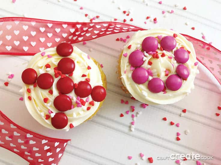 These Easy to Make Valentine Cupcakes with a simple to recreate decoration are the perfect Valentine's Day treat for a school party for the kids! Everyone will think they are homemade/store bought but only you will know how much time and money you saved by starting with a box mix. #cupcakes #valentines #kenarry
