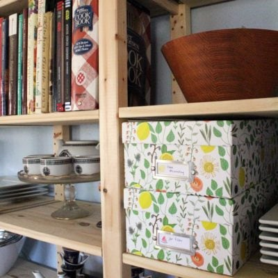 Using open shelving can be pretty and practical for kitchen organizing. All you need are a few photo boxes and some printable labels to not only hide the clutter but make it easy to find when you need it.
