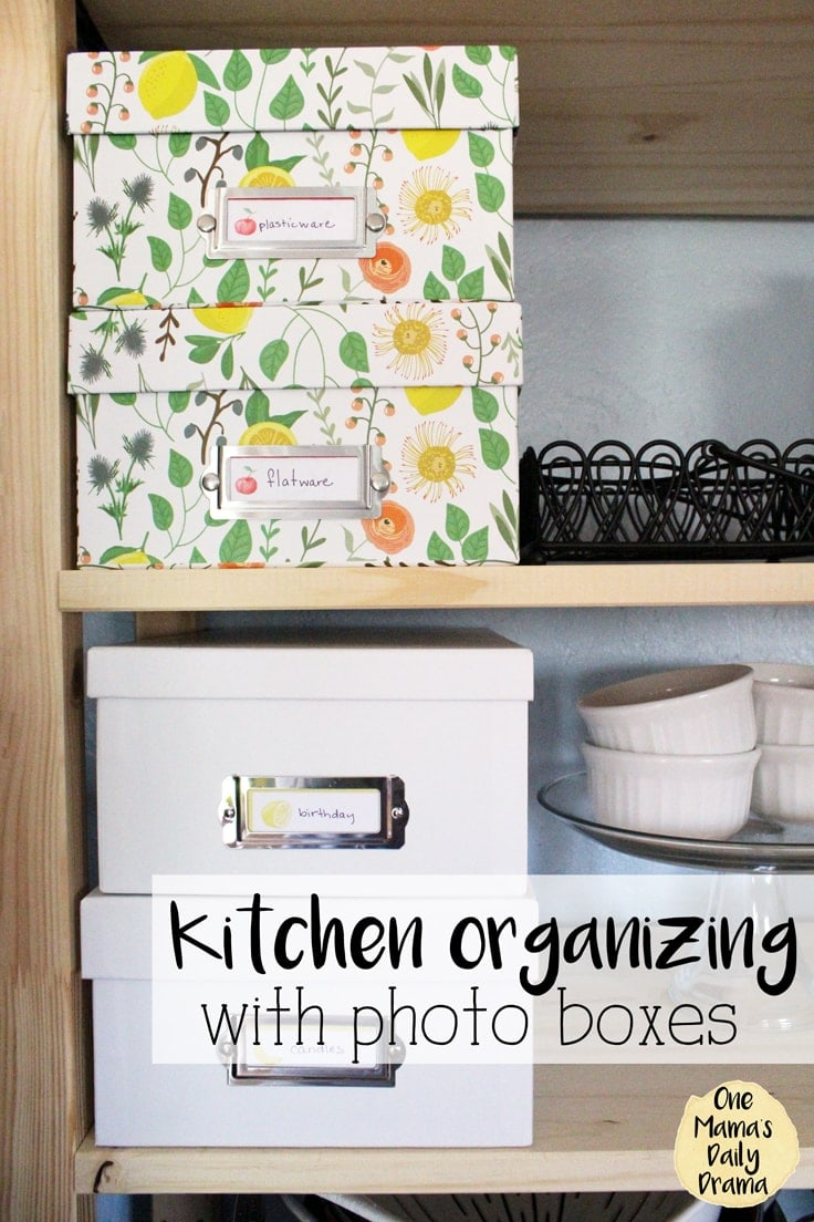 Using open shelving can be pretty and practical for kitchen organization and decor. All you need are a few photo boxes and some printable labels to not only hide the clutter in the kitchen but make it easy to find when you need it. #kitchenorganization #openshelves #kenarry