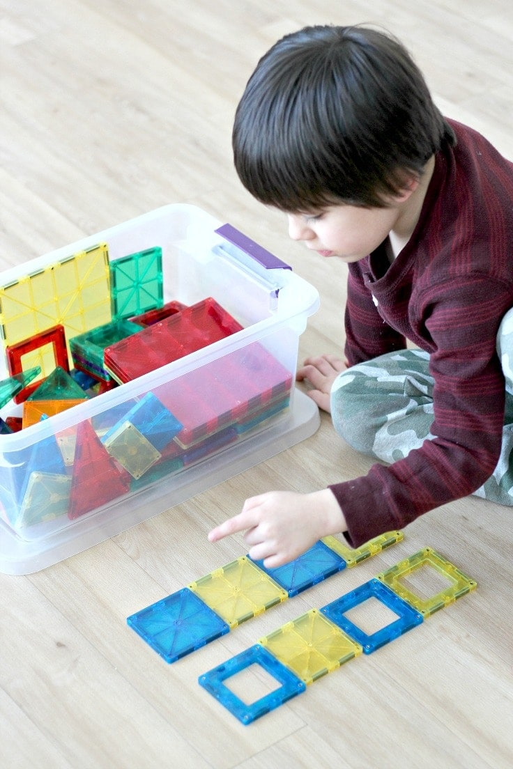 Learn how to teach pattern recognition by playing fun preschool pattern games and activities with magnetic tiles! Pattern recognition is an important early math skill which allows children to replicate patterns while improving fine motor skills, which makes this a great STEM activity. #montessori #preschoolers #kenarry