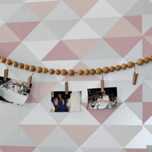 Wood Bead Garland Feature Image With Mini Clothespins and Photos Our Crafty Mom