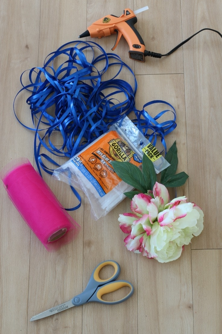 Supplies to make DIY flower wand - faux flowers, hot glue and gun, thin and thick ribbons.