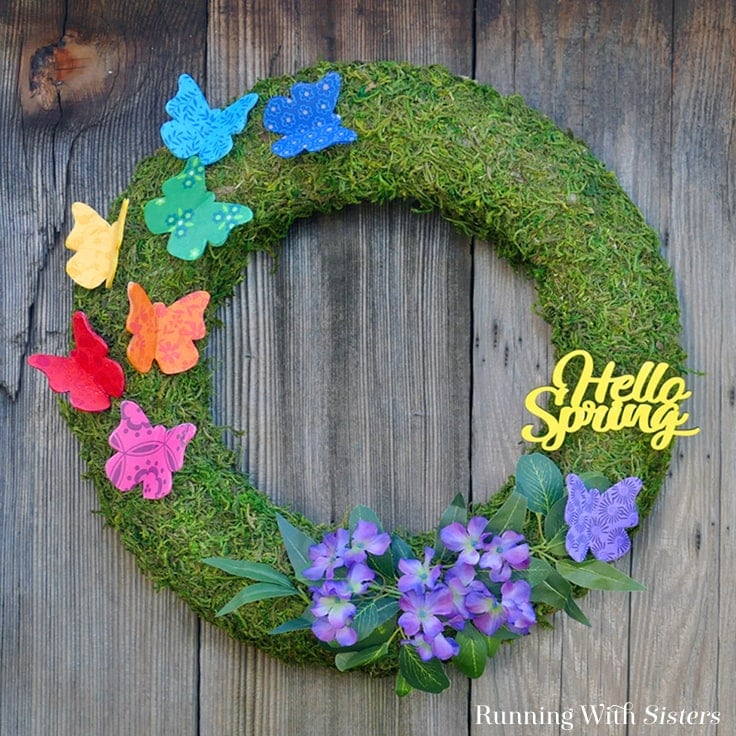 Make a Spring Butterfly Wreath with colorful butterflies! We'll show you how to decoupage wood butterflies with fabric to make your own DIY wreath.