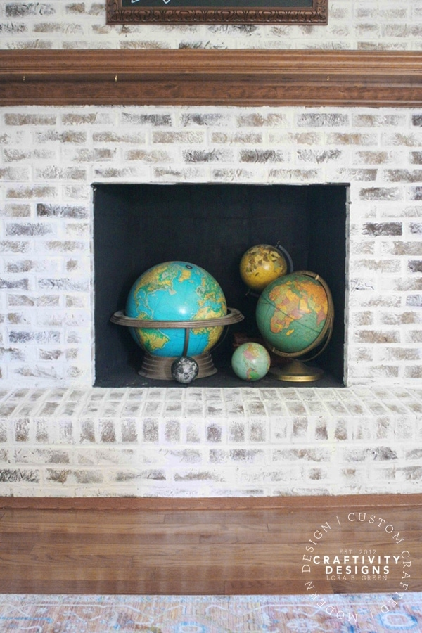 3 Non-Working Fireplace Ideas, Vintage Globes in a Firebox, by Craftivity Designs