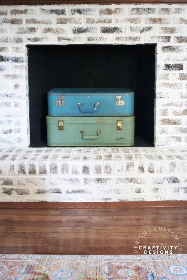 3 Non-Working Fireplace Ideas, Suitcase stacked in a Firebox, by Craftivity Designs