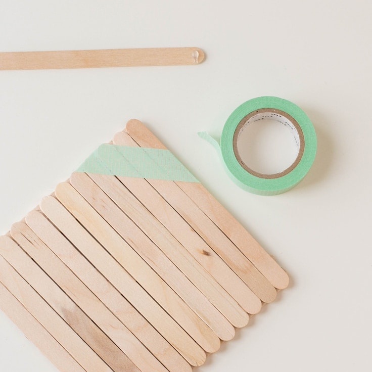 How to make a popsicle stick craft. Final step is to add washi tape as decoration.