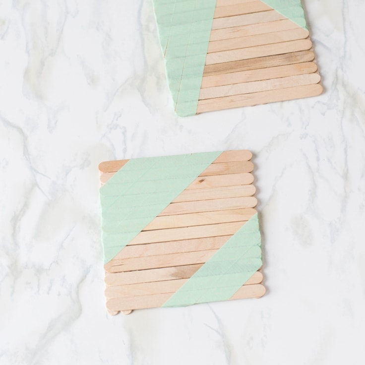 An easy popsicle stick craft tutorial to create your very own coasters!