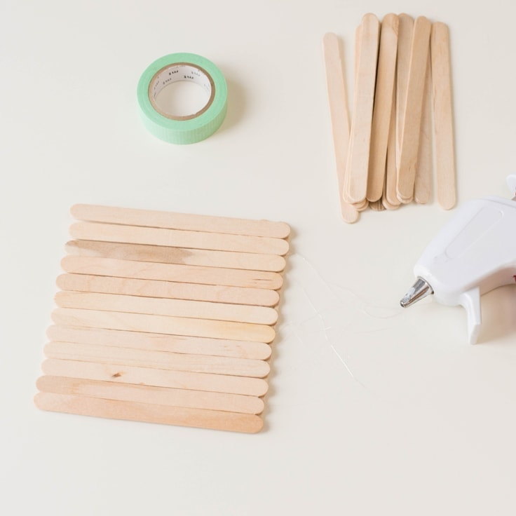 How to make a popsicle stick craft. Third step is to glue sticks side by side.