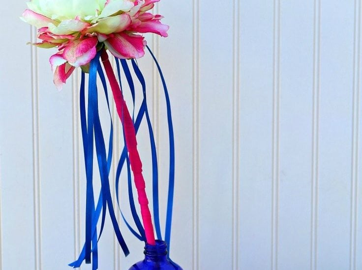 A close up of a ribbon flower wand