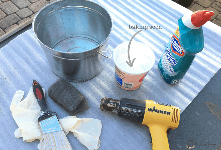 Tools needed to galvanize a metal pail.
