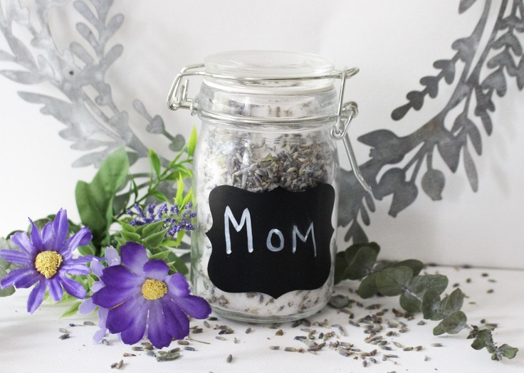 lavender sugar scrub in a decorative mason jar that says