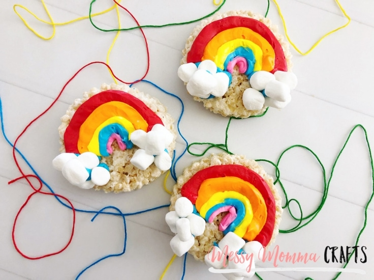 Completed Rainbow Rice Krispie treats with green blue, yellow and red string in the background.