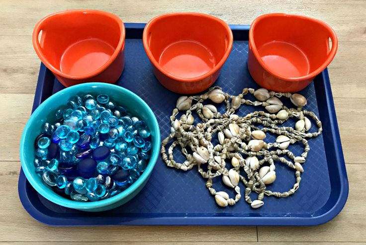 Shells on a tray with glass gems