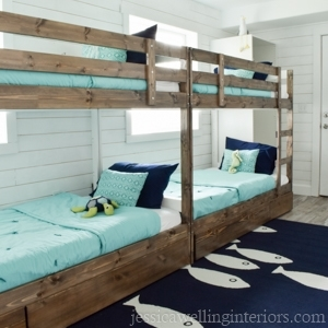 This fun ocean themed bunk room is the perfect sleepover spot for the kids on vacation!