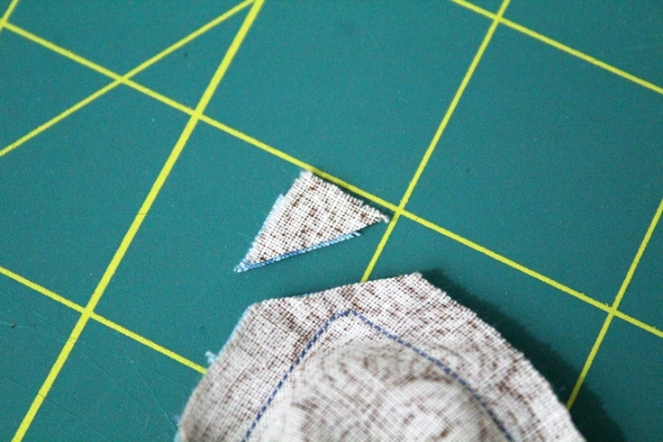 close up of fabric with the corner cut off