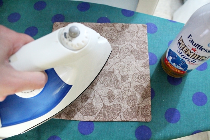 ironing the fabric again with starch