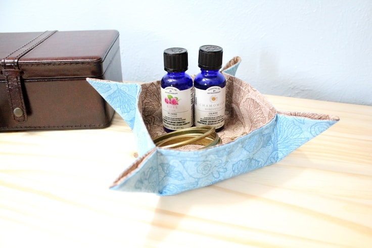 finished fabric tray sitting on a nightstand with essential oils and jewelry inside
