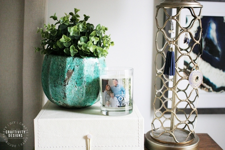 Potted Plant, Personalized Candle, Decorative Box, and Brass Trellis Lamp as Nightstand Decor