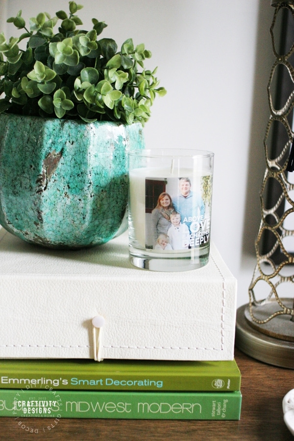 Potted Plant, Personalized Candle, Decorative Box, and Coffee Table Books as Nightstand Decor