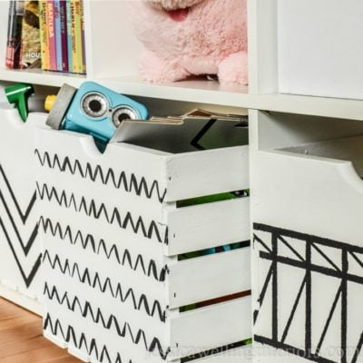 Learn how to paint wood crates with this simple tutorial! These wood crate storage ideas are perfect for storing toys, books, games, DVDs, and more!