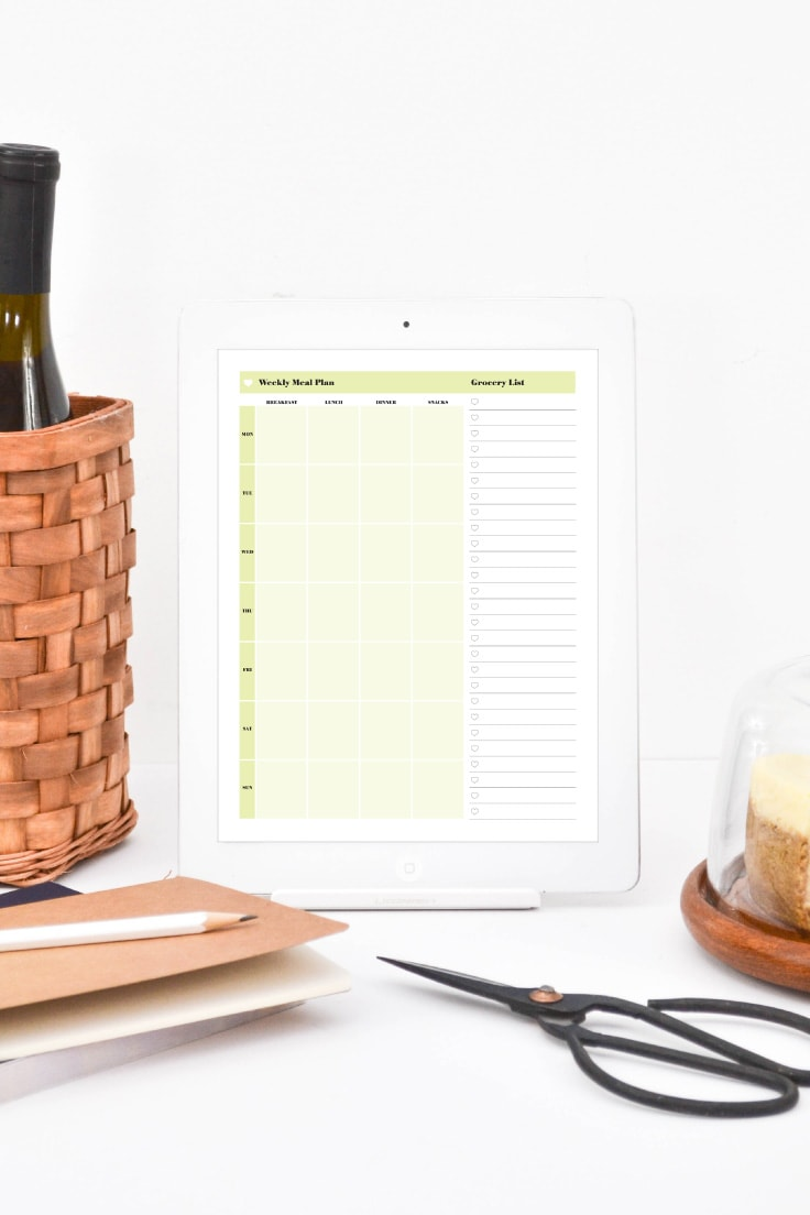 Weekly meal planner on ipad on the kitchen counter.
