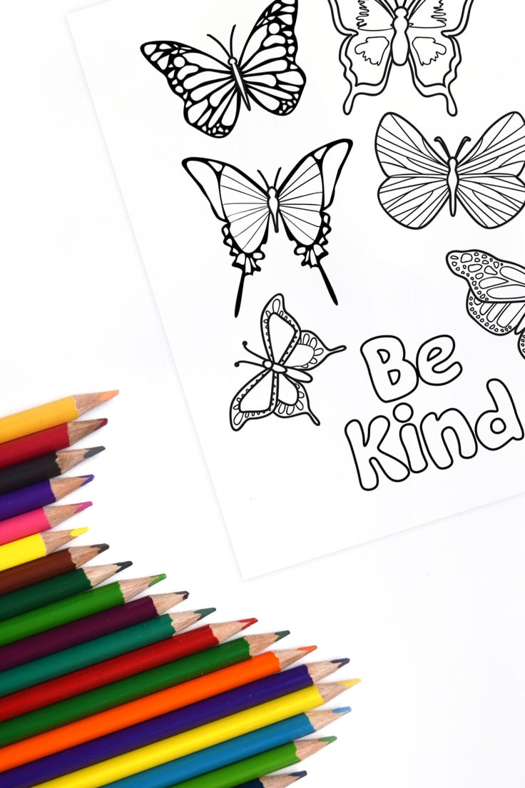 Butterfly design coloring page printable with positive message Be Kind and colored pencils.