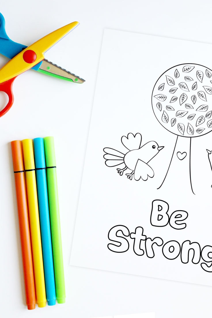 Kids scissors and markers with a printable coloring page design that features Be Strong phrase.