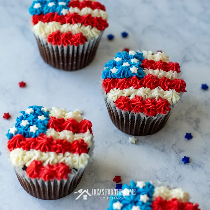 Frosting is used to make chocolate cupcakes look like American flags for the 4th of July