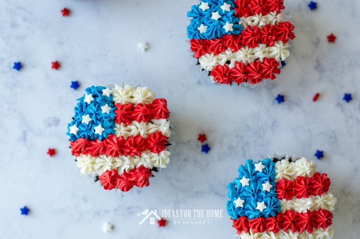 Overhead view of the frosting on cupcakes for the 4th of July. Each one is decorated with red, white and blue frosting to look like an American flag.