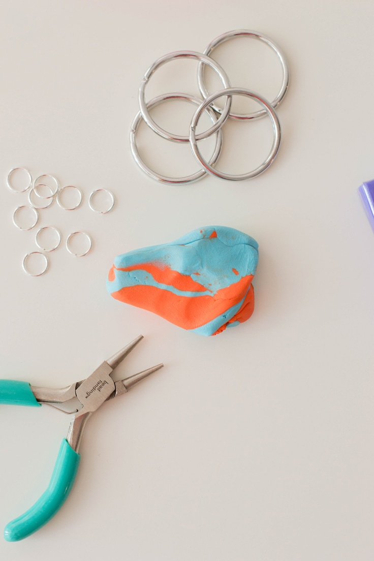 Kneading polymer clay to create a 'marbled' look for our DIY personalized keychain.