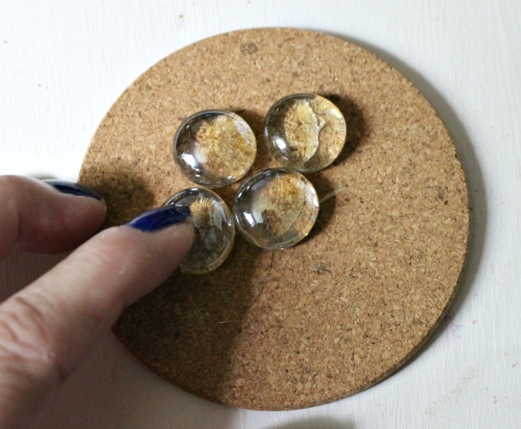 placing glass gems on cork coasters