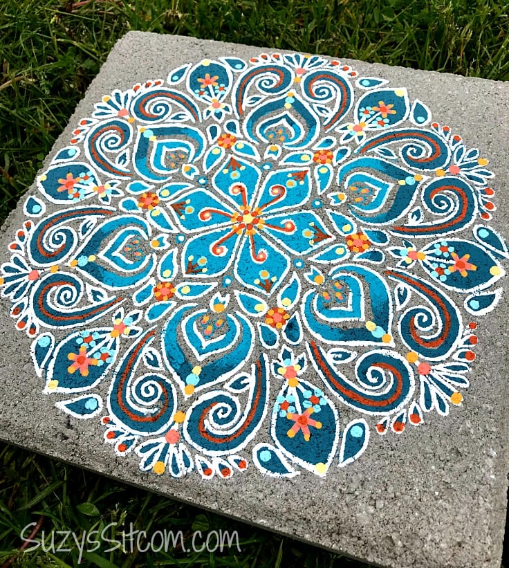 An elaborately painted stepping stone that used stencils.