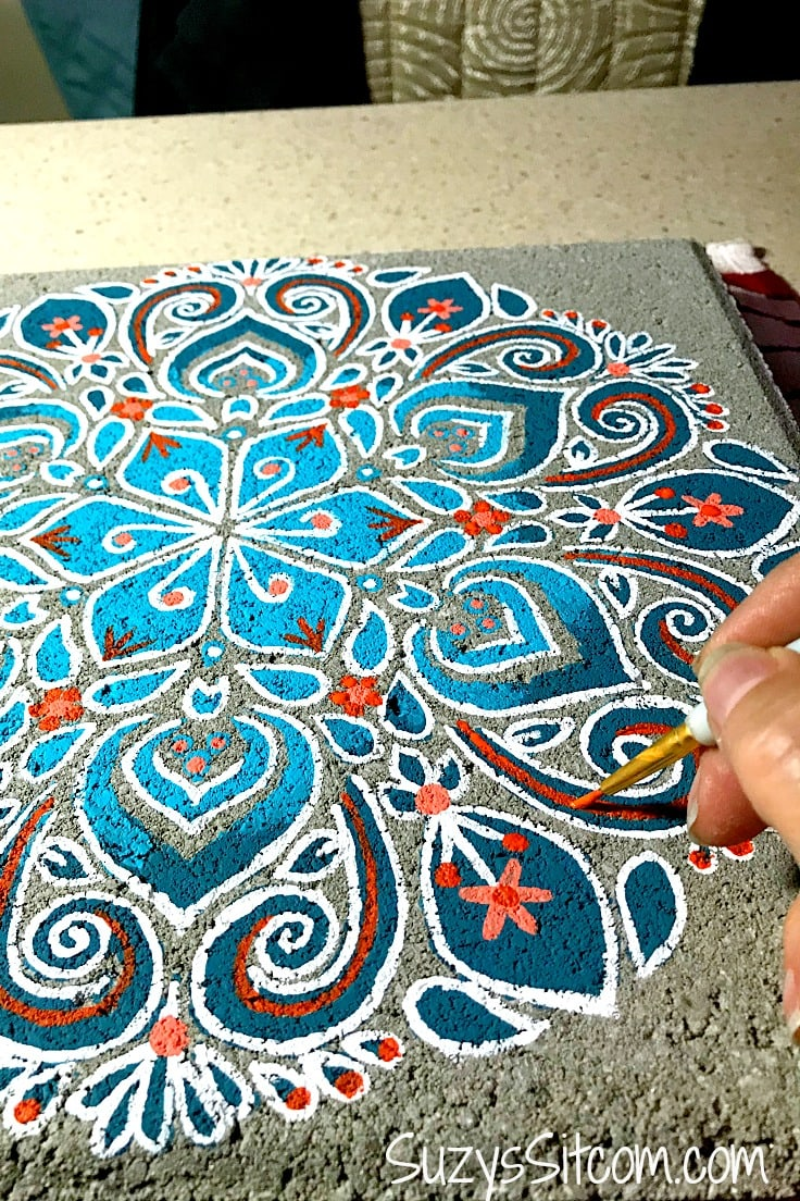 Add red accents by hand to the stepping stone.