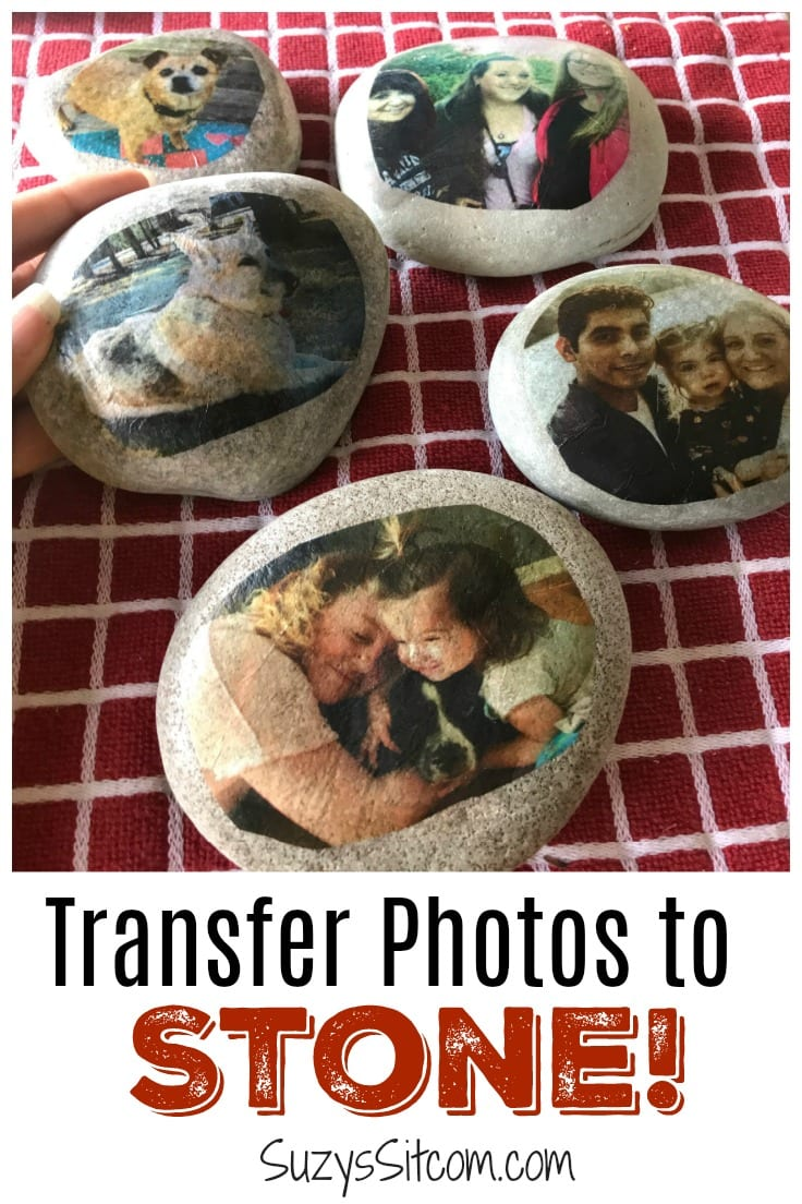 A collection of smooth stones decorated with photographs of families and pets.