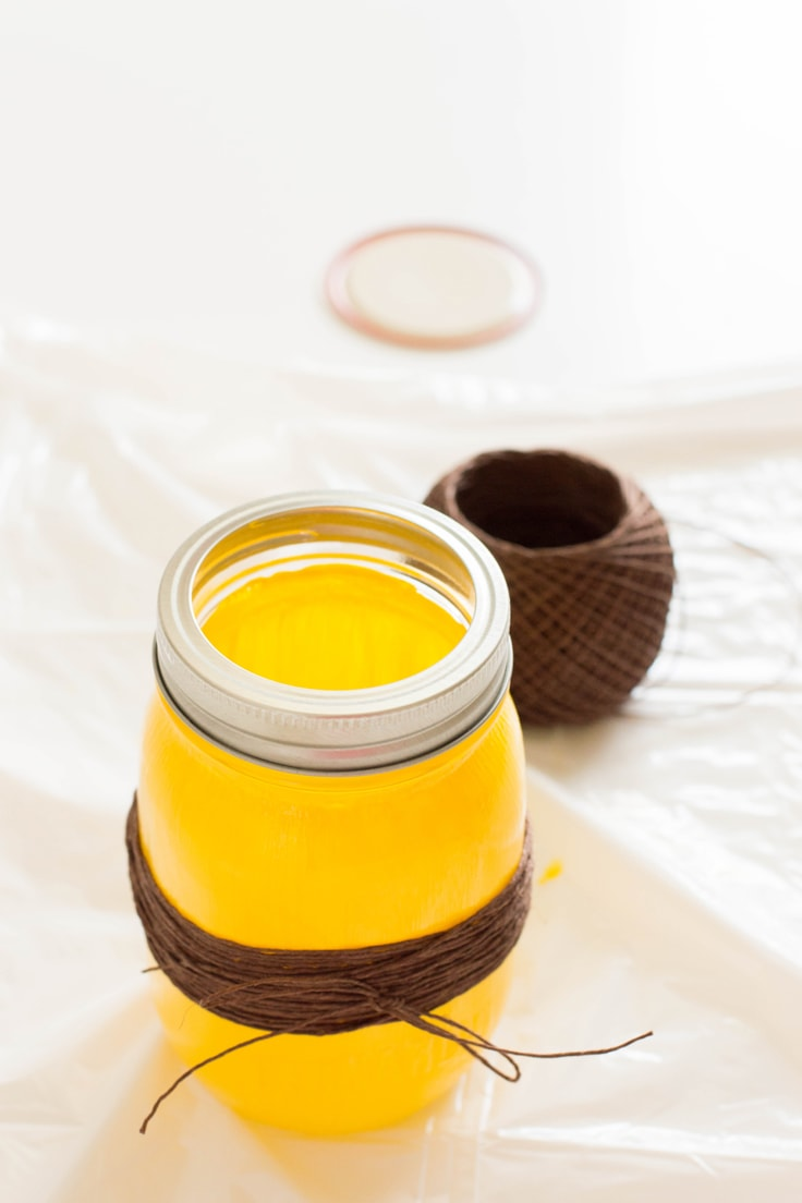 The yellow mason jar and brown twine with the silver band on the top.